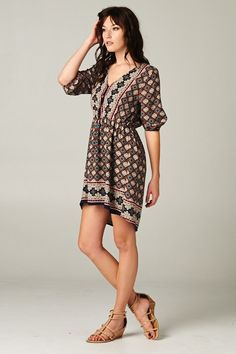 Gorgeous print dress with fabulous fall style. Wear alone or with leggings.