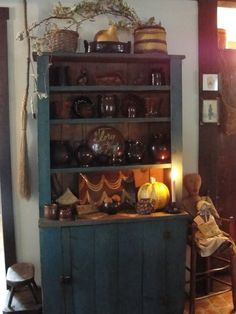 Love the blue of the hutch combined with the earthy tones of redware and treen.