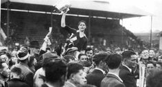 1944 - Captain Sean Condon is shouldered high with the Liam MacCarthy Cup after Cork beat Dublin to complete the four in a row