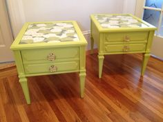 A fun pair of green floral side tables with gold hardware