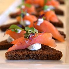 Smoked salmon with dill cream cheese on crisp pumpernickel toast.