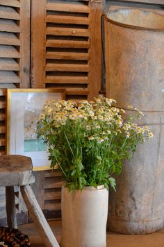 Spring comes to Giannetti Home!  French harvester, antique shutters, and vintage stool...