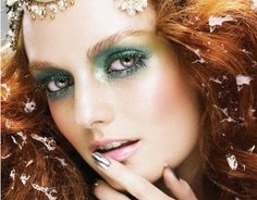 I love the overall look of this makeup. She is so ethereally beautiful, she could be any member of the fae. I like how the look is concentrated on her eyes, and the rest of her face is subtly glowing. Silver nails are a nice touch, and make her eyes seem silver as well.