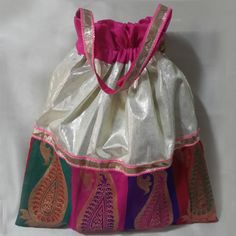 Beautiful and fashionable potli add to a special festive touch to any occassion.