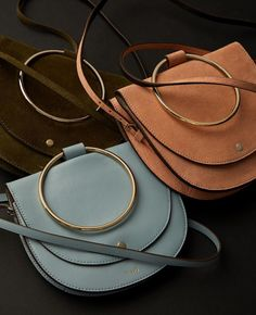 The Whitney bag: Now available in three new colors and fine suede. Shop now at Theory stores and theory.com. Link in bio.