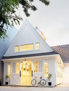 We see a lot of white houses these days, but this Dutch inspired exterior stands out with barn doors, a steep gable, and beautiful millwork. The LOMBARDI HOUSE: Designed by Amber Interiors Images by Zeke Ruelas Styling by Cleo Murnane for Project M plus Houses Architecture, Architecture Design, Sustainable Architecture, Installation Architecture, Casas Containers, Amber Interiors, Home Fashion, My Dream Home, Dream Art