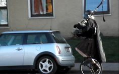 Darth Vader on a unicycle playing the bagpipes.