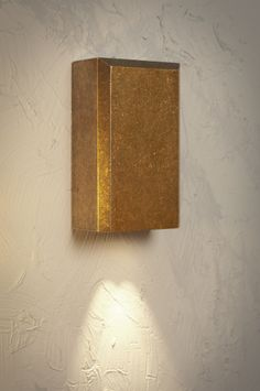 The Newport Downlighter in Antiqued Brass. Perfect for illuminating focal points in your garden.