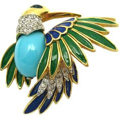 A highly sought after and very hard to find Jomaz dimensional bird brooch.  The bird has a blue glass cabochon tummy and blue and green enamel and