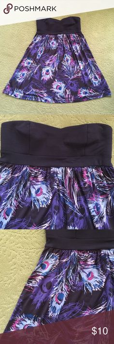 Feather Print Strapless Dress Purple Forever 21 Dress.  Top is more of a cotton feel and has a bustier type look.  Some pilling on the top.  Skirt of dress is stretchy and slinky and has feathers printed throughout.  So pretty and perfect for spring/summer! Forever 21 Dresses Strapless