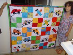 Keep Movin' - baby quilt for a dear friend's baby boy. Applique cars, trucks and airplanes. Stipple quilted in the four patch blocks. Pieced binding done with FQ offcuts.