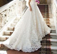 Lace wedding dress with long train.