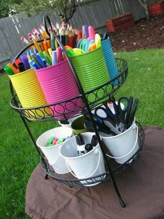 School Supply Caddy: Using a serving plate stand or even maybe a plant stand, you paint cans in whatever colors, get buckets and fill with school supplies or art supplies. Kids can use & put back easily. Go one step further and label each can. School Supply Caddy, Kids Homework Station, Homework Caddy, Kids Homework Room, Ideas Para Organizar, Diy School Supplies, Office Supplies, Organize Art Supplies, School Supplies Organization