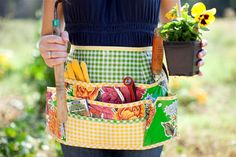 """Oilcloth Garden Apron  ur pretty and practical garden apron has lots of great pockets to keep all your garden tools handy and safe.  As seen in Birds and Bloom Magazine.  Measurements: 12"""" long, 18"""" wide at waist with 28"""" apron strings."""
