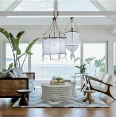Love everything about this room: Those lamps! The view!