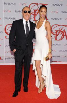 2012 CFDA Fashion Awards - Arrivals; black tux fan!