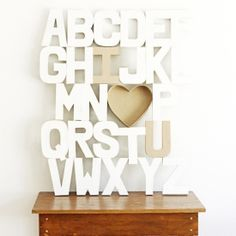 Make this large art piece with just paper mache letters, spray paint and a glue gun!