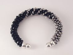 Cuff bracelet with black and silver crystal beads por SelwerJewelry
