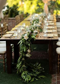 Table Runner: What could be lovelier then a garland of greenery running down the center of your reception table? 10 Simple Yet Stunning Ways To Use Greenery In Your Wedding
