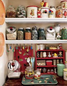 I adore this retro pantry -- I have some of my Mom's red topped metal canisters and have collected more.  Love the '50s colors!