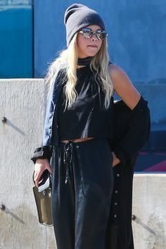 Sofia Richie, giving us all sunglasses envy in her black beanie and drawstring joggers.