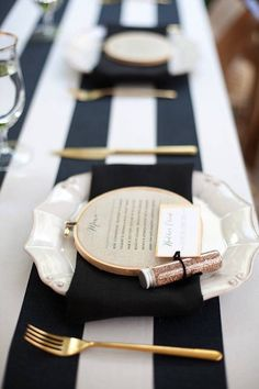 Simple #classy black and white striped table linen and gold #cutlery make this #wedding table so elegant
