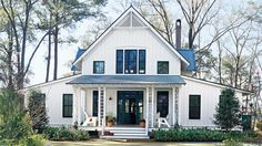 Create a place where tradition can endure, here's a casual cottage with Folk details such as latticed porch columns, a steeply pitched roof and exposed rafters. A