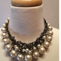 Pearl and Metal Necklace Edgy necklace made with pearls for class and metal chain link for sass! Four layers of gorgeous necklace! Jewelry Necklaces