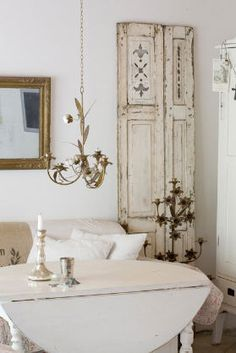 Painted Vintage Old Shutters....used against the wall as a decorative element in the room...