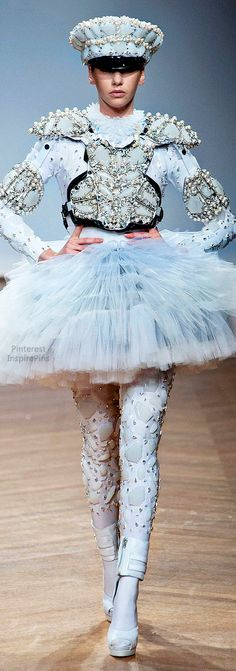 REALLY!?!?!? So now we can go as a cross between a ballerina, Dart Vador and  a cop?! Classic On Aura Tout Vu Spring 2014 Couture