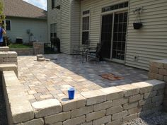 When we bought the house, we knew that we wanted to get rid of the concrete slab out back and put something a little more inviting in. About 6 months after we settled in, we started the tiring, but highly rewarding, process of creating our outdoor oasis.  This project is a lot of work, but it will
