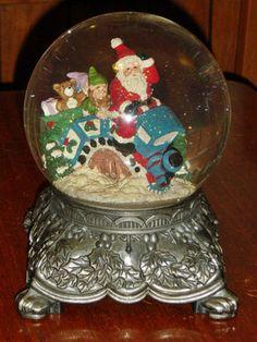 Vintage Christmas Snow Globe ~ Santa and Elf Riding Christmas Train. ---What a beautiful, ornate base on this globe. My Grandmother had one. Christmas Snow Globes, Christmas Train, Christmas Past, Vintage Christmas Ornaments, Christmas Crafts, Chrissy Snow, Vintage Snow Globes, Snowman Snow Globe, I Love Snow