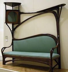 Art Nouveau Setee. I need this. I would put a small cat in the case. This is where I could eat my toast and drink my mimosa, while enjoying the small cat in the case.