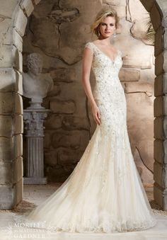 Wedding Dress 2788 Crystal Beaded Embroidery Cascades onto the Net Gown Over Soft Satin with Scalloped Hemline