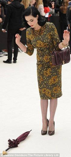 Dita Von Teese drops her umbrella at LFW show... and avoids embarrassment by summoning helpers to pick it up | Mail Online