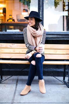 A striped tee, oversized scarf, and a fedora