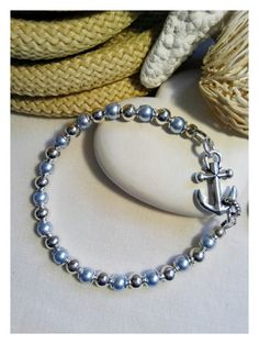 Check out this item in my Etsy shop https://www.etsy.com/listing/232472110/ice-blue-pearl-and-silver-bead-bracelet