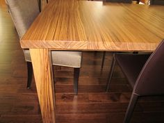 Huntington Beach kitchen-Custom Zebra wood dining table! AMAZING!! Check out the Zebra wood sofa console that goes around the entire back of a sectional.