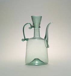 Ewer Date: century Geography: Iran Culture: Islamic Medium: Glass, green; blown, applied handle and spout Glass Bottles, Perfume Bottles, Glass Figurines, Antique Glass, Hand Blown Glass, Heritage Image, 19th Century, Poster Size Prints, Glass Art