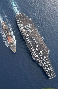 Aerial view of aircraft carrier, and supply tender.