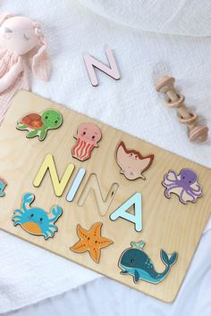 Zoo Baby Shower Gift - Wooden name puzzle by WoodilyToys. Jungle Animals - Personalized new baby gift Newborn - New to the Zoo Onesies. First Christmas gift for baby. Our Personalized custom name puzzles are designed to fuel imagination, inspire exploration and encourage the natural curiosity that leads to a lifetime of learning. #kidstoy #busypuzzle Wooden Toys For Toddlers, Wooden Baby Toys, Toddler Toys, Kids Toys, Newborn Baby Gifts, New Baby Gifts, Baby Decor, Nursery Decor, Diy Sensory Board