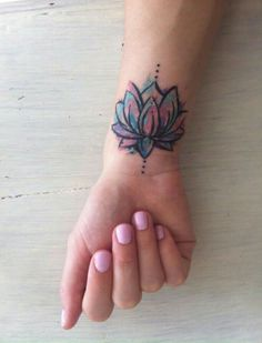Small watercolor lotus flower tattoo