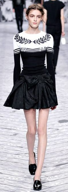 The sweater. Maybe with a pencil skirt or tailored slacks...  Viktor and Rolf F/W 2013