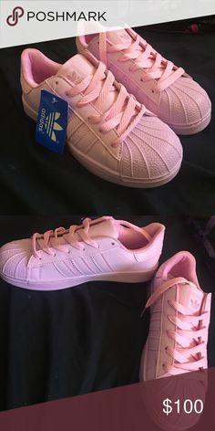 NWT Baby Pink Adidas Superstars 7 in juniors. NWT. Fit me barely too tight as a woman's 8.5 , probably fit woman's 8 perfectly. Save on shipping and get a discount when you make a bundle! adidas Shoes Athletic Shoes