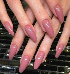 Mauve pink nails.