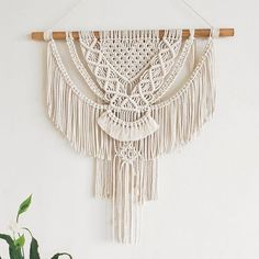 Limited edition Macramé Wall Hanging. Only 5 made to order, take your pick of natural tasmanian oak, Old Baltic or Teak stain. Pictured stained in Old Baltic. Measuring 49cm wide x 90cm height from hook to bottom.