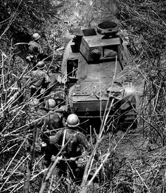 Type 97 Shinhoto Chi-Ha (Type 1 47 mm L/53,7) From the caption: Soldiers of the 37th Infantry Division moving past an abandoned Japanese Type 95 Ha Go light tank near Aritao, Luzon during the 1945 campaign in the Philippines. Aritao had been defended by the Japanese 2nd Tank Division. Elements of the 2nd and 10th Tank Regiments had established defensive positions around the village, so this track is from one of those elements.