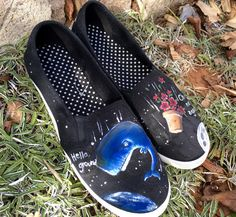 Custom hand-painted canvas shoes featuring characters from the book The…