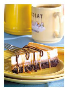 Brownie caramel cheesecake    1 (9 ounce) package brownie mix  1 egg  1 tablespoon cold water  1 (14 ounce) package individually wrapped caramels, unwrapped  1 (5 ounce) can evaporated milk  2 (8 ounce) packages cream cheese, softened  1/2 cup white sugar  1 teaspoon vanilla extract  2 eggs  1 cup chocolate fudge topping