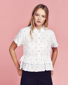 Same with the bottom of this shirt it has a very girly look to the bottom of it because of the ruffled peplum.
